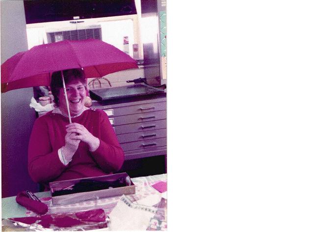 Mother posing under her umbrella